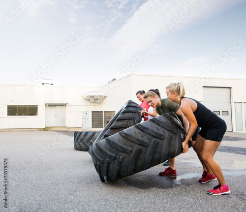 Tuinposter Gymnastiek Athletes Flipping Tires