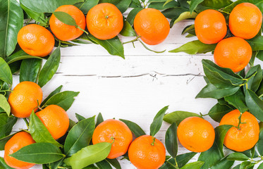 Fresh mandarin fruits frame, space for text
