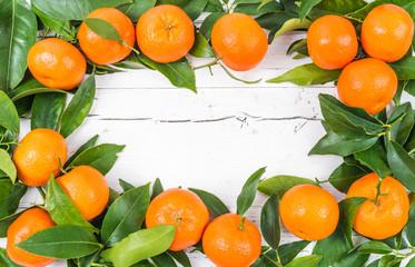 Fresh mandarin fruits frame, space for text