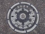 Manhole drain cover on the street at Nikko, Japan