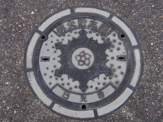 Manhole drain cover on the street at Nikko, Japan