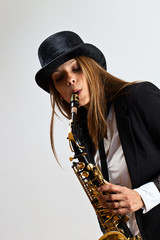 young beautiful woman with saxophone