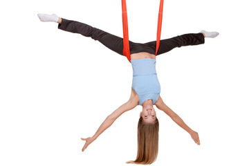 Young woman making antigravity yoga exercises in stretching