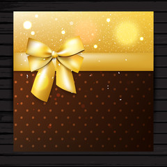 Brown and gold colors card with bow