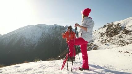 Couple rich mountain summit, hug