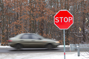 Stop road sign with traffic cars