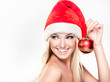 Christmas smiling surprised girl . Beauty Model in Santa Hat