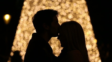 silhouette of young couple on blurred light background