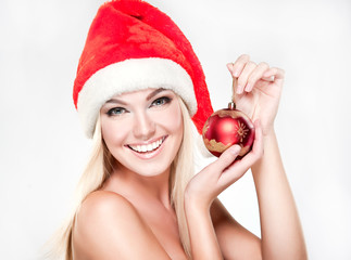 Christmas smiling surprised girl . Beauty Model in Santa Hat