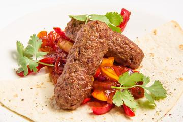 kebab and vegetables in sauce