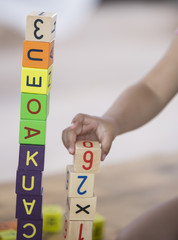 Close-up of girl playing with blocks at home
