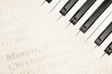 vintage mozart text and piano keys background