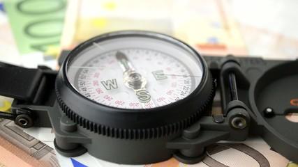 close up of euro money & compass