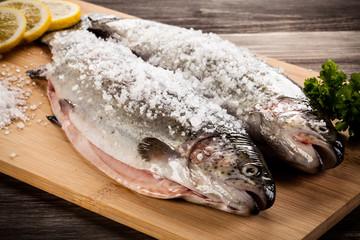 Fresh raw trouts on cutting board