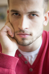 Close-up portrait of confident man in cafe