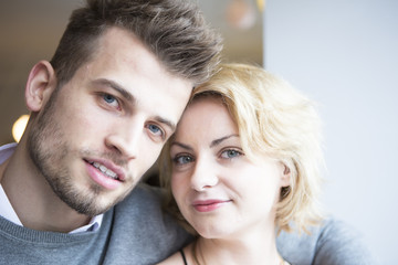 Close-up portrait of young couple in cafe