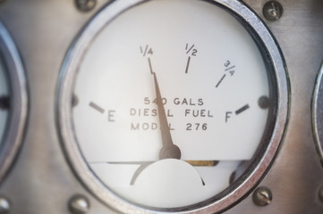 Close-up of diesel fuel gauge of yacht