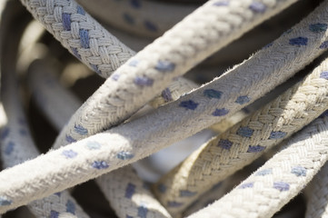 Rope wound around winch on sailboat