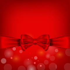 bright red bow on the red  holiday background