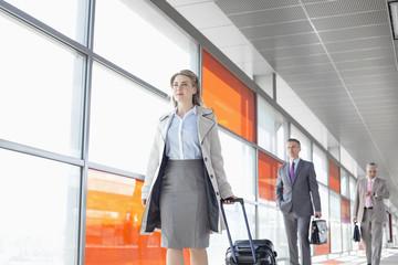Businesspeople walking on train platform