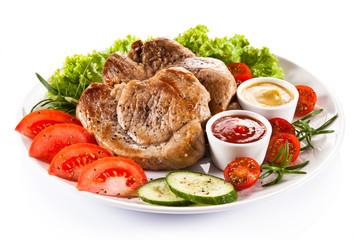 Barbecued steaks and vegetable salad