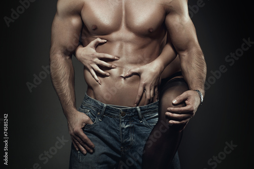canvas print picture Sexy young couple body at night closeup