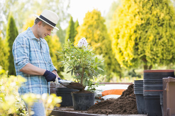 Man planting pot at garden