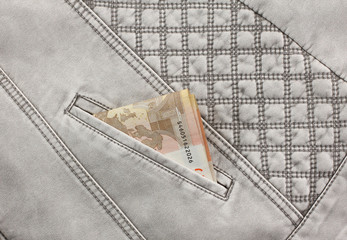 euro banknote sticking out of pocket