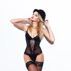 Sensual blonde woman in hat posing