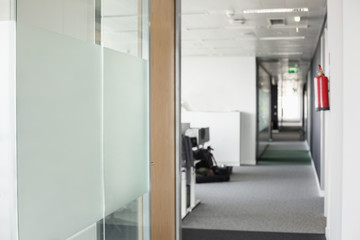 Glass wall and narrow passageway in office