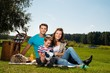 Young family having picnic outdoors
