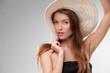 Beautiful girl with hat posing in studio