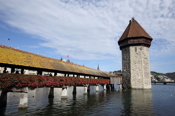 View on the old wooden chapel bridge in Lucerne Switzerland .