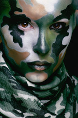 Beautiful young fashion woman with military style clothing and