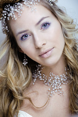 beauty young snow queen in fairy flashes with hair crown on her