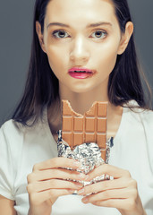 cute young female with chocolate close up eating