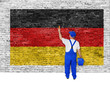 Painter covers brick wall with flag of Germany