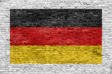 German flag painted over brick wall