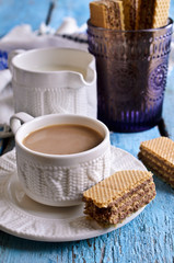 White mug of brown liquid