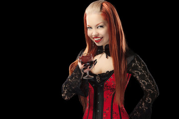 Portrait of redheaded gothic girl with glass