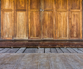 Wooden doors and floor of traditional Thai house