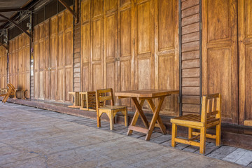 Wooden doors, table, chairs and floor of old Thai house