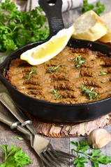 Pate from beef liver and vegetables baked in frying pan.