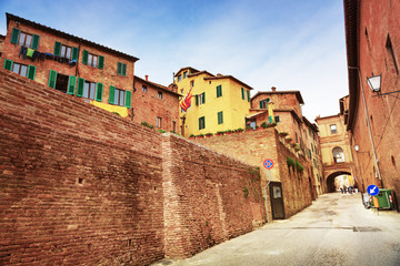Small town street view in Sienna, Italy
