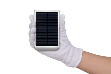Solar panel charger in human hand with glove isolated on white