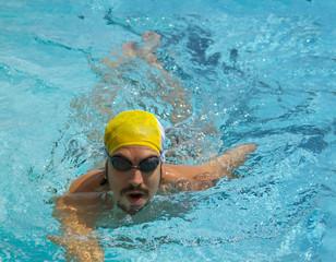 portrait swimmer beautiful boy swims in pool crawl