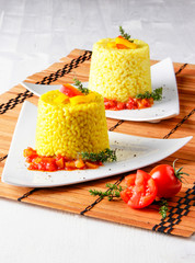 saffron rice pudding with cherry tomatoes