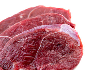 Macro closeup of leg lamb meat steaks isolated on white