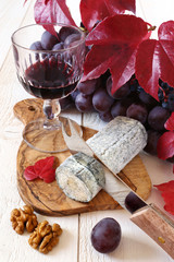 French blue cheese, walnuts, grapes and a wineglass