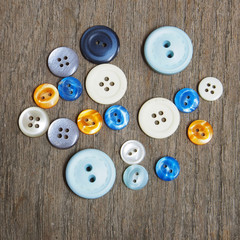 Group of buttons on the wooden table